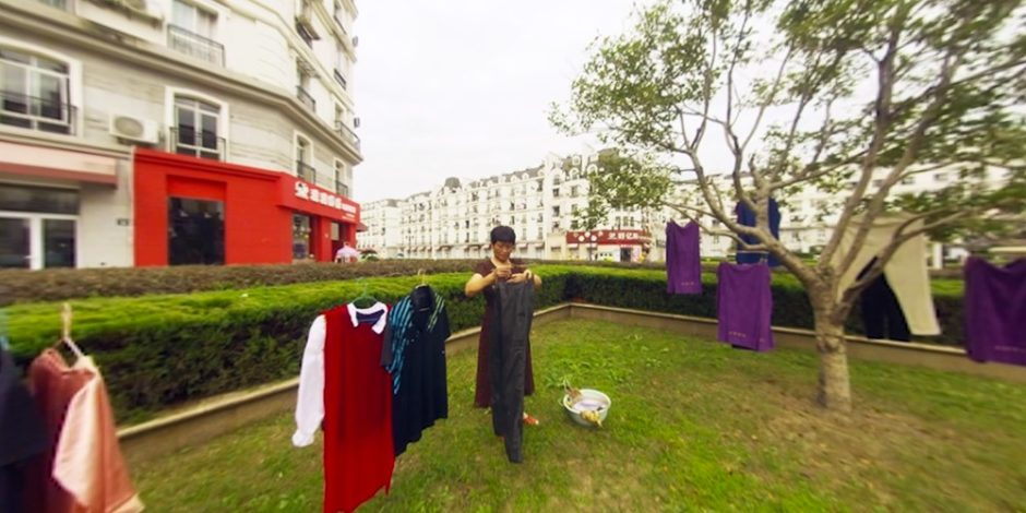 Chinese man hang-drying his clothes outside, in Tiendu Cheng