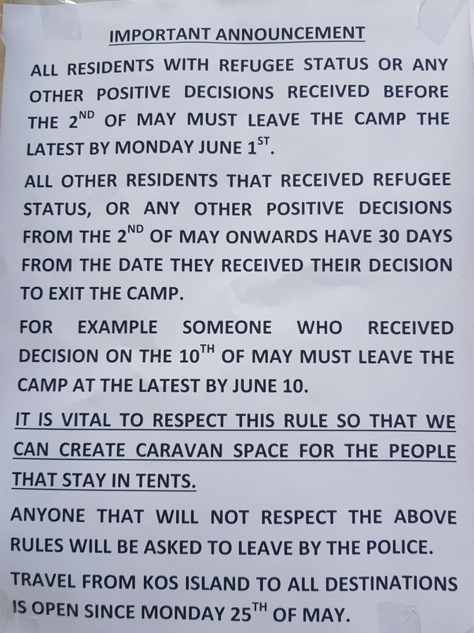 Photograph of sign explaining the eviction process for Refugees in the island of Kos.