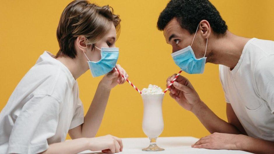 Paradox of two people wearing masks and drinking a milkshake.